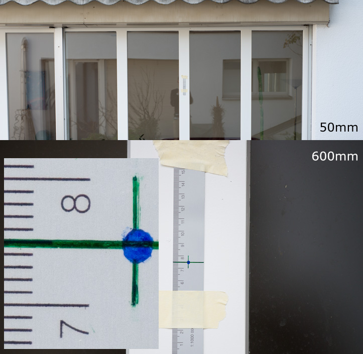 Photo of a ruler showing a comparison of a 50mm (full size) with a 600mm lens at pixel level (100%)